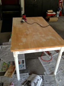 Sanding the tabletop with a Skil Orbital Sander
