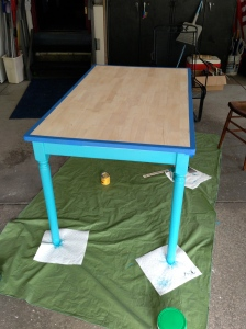 Table with painters tape and legs painted blue