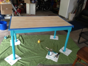 Table with blue painters tape and legs painted